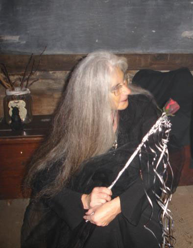 Photo of Bess Sturgis kneeling (as Ghouliana Stories)
